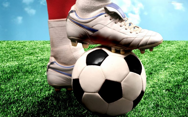 Foot on a football wallpaper